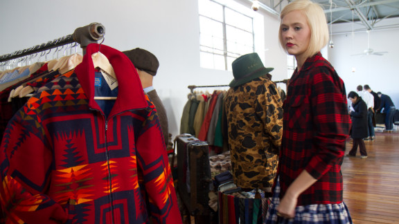 Karyn Dethrow tries on clothes at the MidNorth Mercantile boutique, which rescues and restores classic American vintage from estate sales and yard sales.