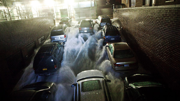 Rising water rushes into an underground parking garage in New York