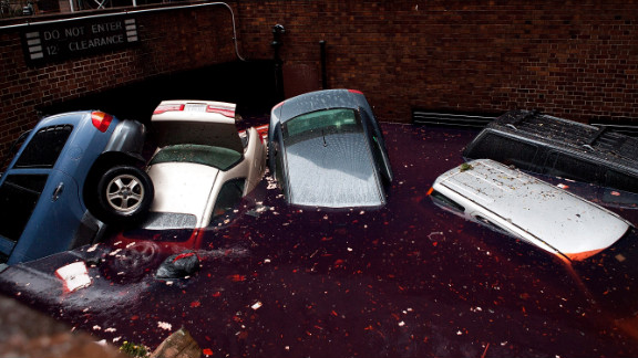 Cars float in a flooded parking area on Tuesday in the financial district of New York.