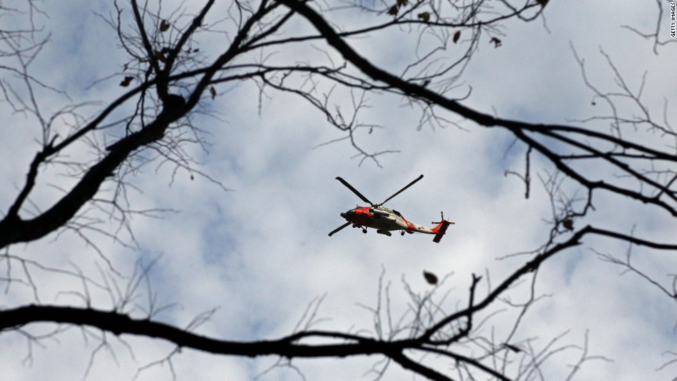 A U.S. Coast Guard helicopter flies over Central Park in New York on Tuesday.