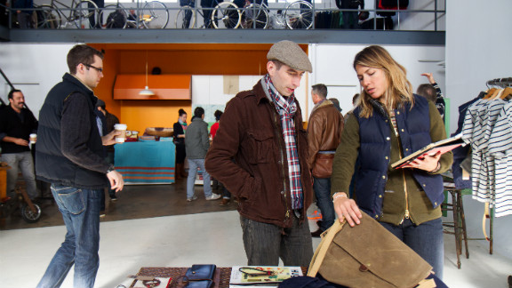 Nicole Sorenson of Archival Clothing talks product with a customer. The Oregon-based brand is known for its minimalist bags and backpacks. Its hats and sweatshirts were popular sellers at NorthernGRADE.