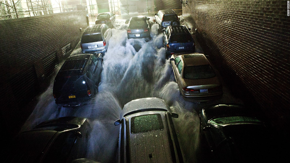 Rising water rushes into an underground parking garage in New York's financial district on Monday, October 29.