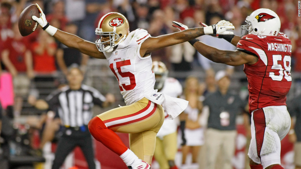 Michael Crabtree of the 49ers celebrates as he beats Daryl Washington of the Cardinals into the end zone for a touchdown Monday night.