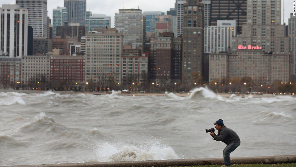 A photographer shoots waves in Lake Michigan generated by the remnants of Sandy as they crash into the Chicago shoreline on Tuesday.