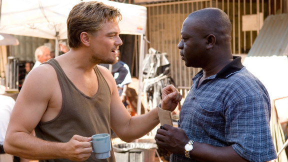 """After filming his award-winning documentary """"Cry Freetown,"""" on the war in Sierra Leone, Samura became a consultant on the Hollywood film """"Blood Diamond"""". Here, he is pictured talking to Leonardo DiCaprio on the set of the film."""