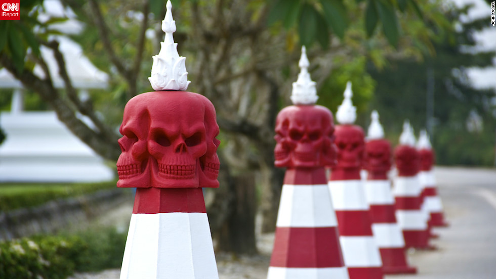 "The White Temple in Chiang Rai, Thailand, is a macabre temple dedicated to preventing people from drinking alcohol and smoking, as both lead to an untimely death. The Halloween-themed pylons <a href=""http://ireport.cnn.com/docs/DOC-859025"" target=""_blank"">caught the eye of John Vogel</a>, who said: ""These pylons are located year round on the road near the temple, but seem especially appropriate this time of the year."""