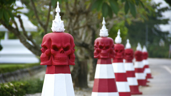 "The White Temple in Chiang Rai, Thailand, is a macabre temple dedicated to preventing people from drinking alcohol and smoking, as both lead to an untimely death. The Halloween-themed pylons caught the eye of John Vogel, who said: ""These pylons are located year round on the road near the temple, but seem especially appropriate this time of the year."""