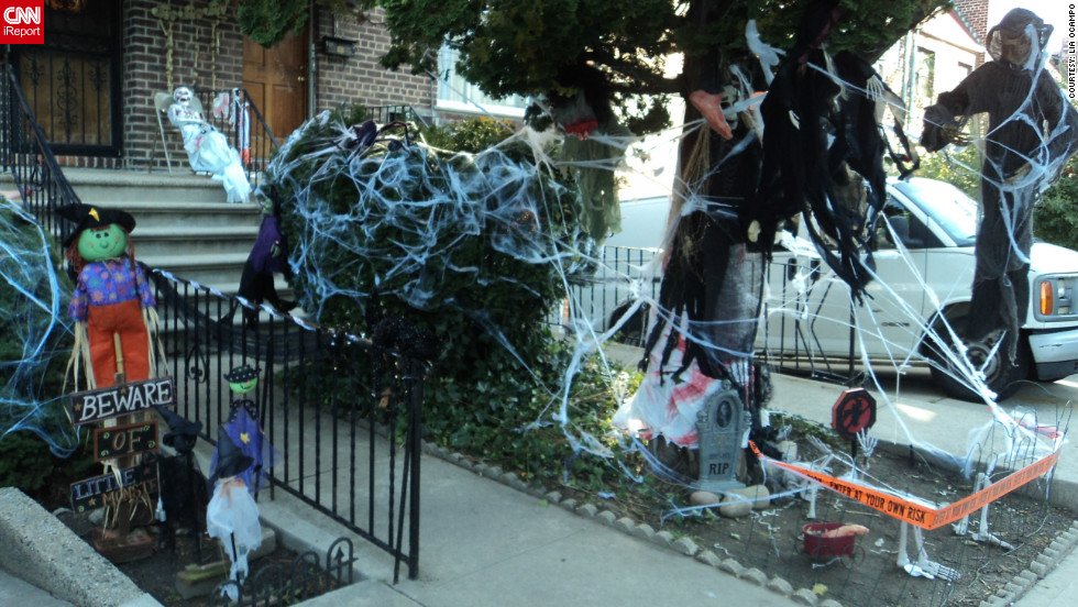 "Lia Ocampo <a href=""http://ireport.cnn.com/docs/DOC-861829"" target=""_blank"">snapped these photos </a>in her neighborhood in New York - she thought this decoration was ""creative and realistic."" To her, Halloween is not only scary, but it's fun as well. It's the opportunity to ""celebrate the lighter side of life,"" said the 43-year-old who submitted a whole series of Halloween decoration photos in her iReport."