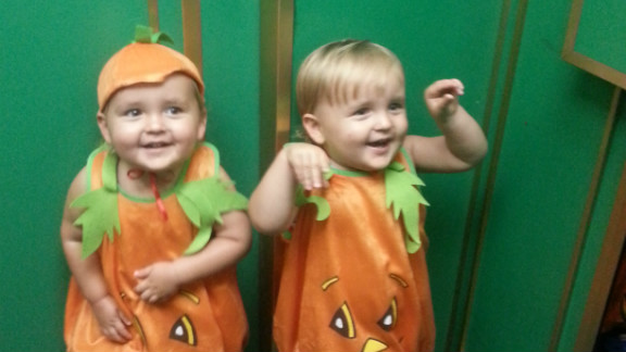 "These happy pumpkins are Hunter and Robert, two nearly two-year-old identical twins who live in Hong Kong with their parents Clinton and Camilla O'Connor. When their dad took this photo the family was on their way to a Halloween party for families with multiple children. ""There were about 30 sets of twins at the party all dressed up,"" said Mr O'Connor."
