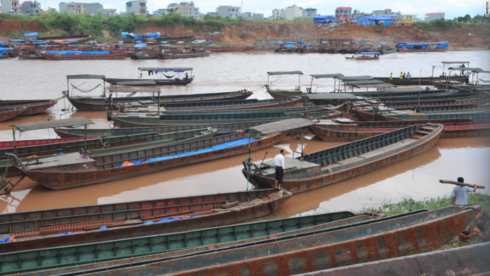 Boats sit in the Beilun River, which separates China and Vietnam, on Tuesday, October 30. Tropical Storm Son-Tinh was moving northeast along the northern Vietnamese coast on Monday after tearing the roofs off hundreds of houses and breaching flood defenses overnight, the state-run Vietnam News Agency reported.