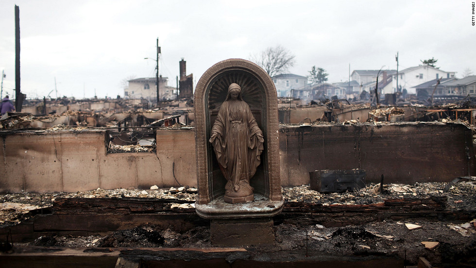 A Virgin Mary statue stands in the Breezy Point neighborhood of Queens, New York, on Tuesday after a fire fed by high winds destroyed at least 80 homes, officials said.