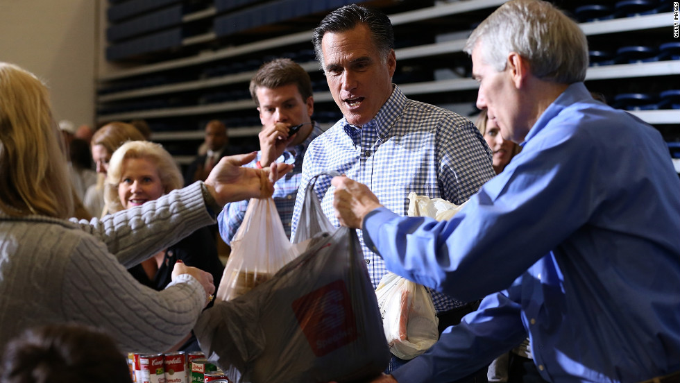 Republican presidential candidate Mitt Romney accepts a food donation for storm victims at an event in Kettering, Ohio, on Tuesday.