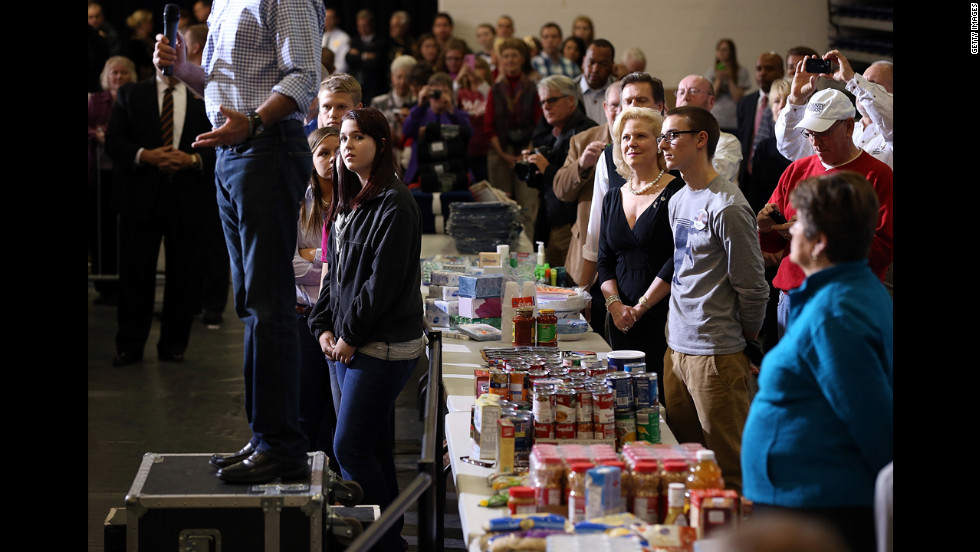 Supporters listen as Romney speaks at an event to collect food and supply donations for storm victims in Kettering, Ohio, Tuesday.