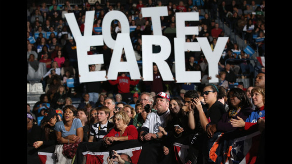 Democratic supporters listen during a campaign rally Monday with Clinton and Biden.