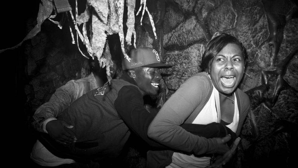 Frightened visitors make their way through the Netherworld Haunted House in Norcross, Georgia. There are an estimated 1,200 haunted houses charging admission across the United States, according to the Haunted House Association.