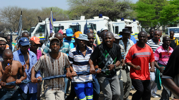 Some of the 12,000 miners sacked by Anglo American Platinum protest their dismissal and mourn a colleague killed in clashes with police