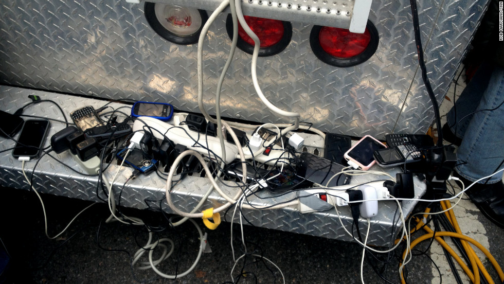 People charge their phones and other devices at operator Ken Ryan's CNN satellite truck in southern Manhattan.