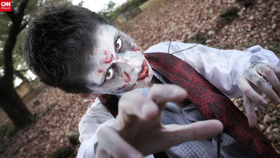"Angel Rausch says her son Ruhl is a 'theatrical' guy, who easily gets into his character - this year, he is dressing as a zombie.Walking back <a href=""http://ireport.cnn.com/docs/DOC-865625"" target=""_blank"">from a photo shoot</a>, Ruhl, still in his zombie outfit, saw a homecoming event at the town square, an opportunity he could not resist. ""He was 'photobombing' the homecoming couples as they were taking pictures with their families,"" she said."