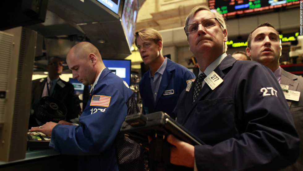 Traders work on the floor of the New York Stock Exchange on Wednesday after it had been closed for two days.