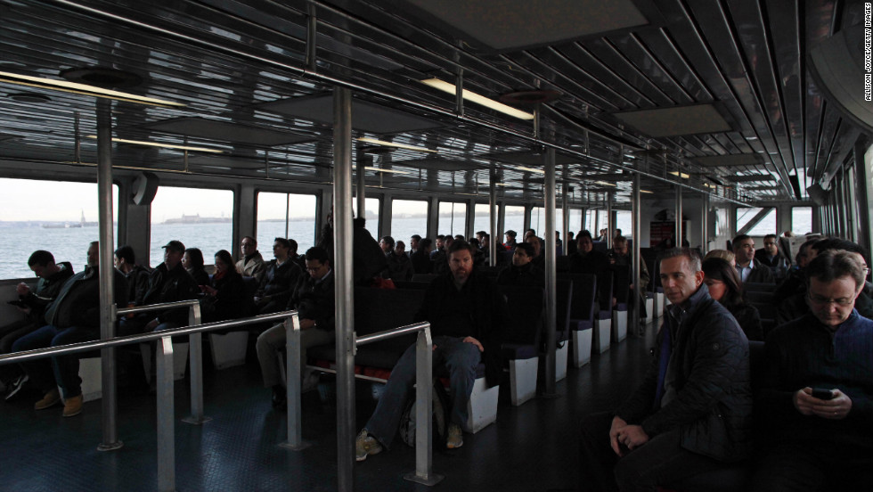 Commuters ride a NY Waterway ferry from Jersey City, New Jersey, on Wednesday, the first day of operation since the storm hit.