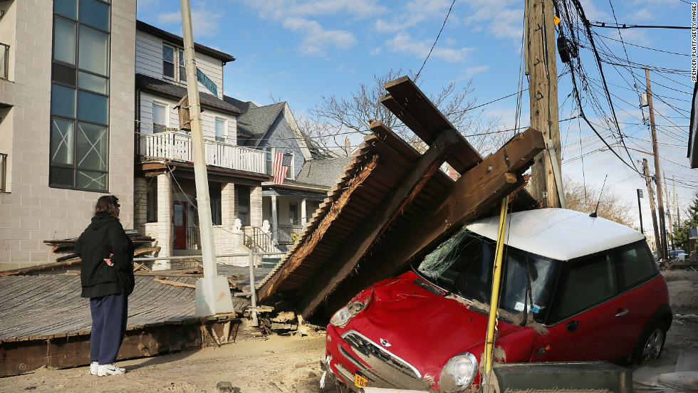 A woman examines damage to the Rockaway neighborhood in New York on Wednesday.