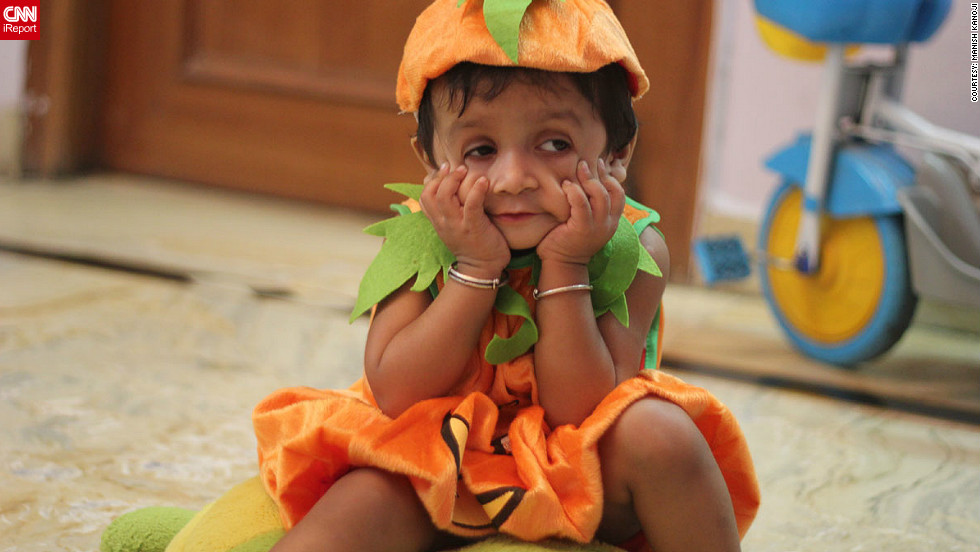 "For <a href=""http://ireport.cnn.com/docs/DOC-869370"" target=""_blank"">Manish Kanoji</a>'s daughter Kyra, this was the first Halloween celebration ever. Although she did not quite understand what was going on (she is 20 months old), she was able to pull an impressive ""scary face"" for this photo."