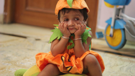 "For Manish Kanoji's daughter Kyra, this was the first Halloween celebration ever. Although she did not quite understand what was going on (she is 20 months old), she was able to pull an impressive ""scary face"" for this photo."