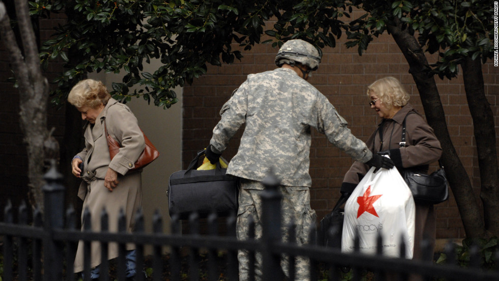 A member of  Army National Guard Unit Gulf 250 from Morristown, New Jersey, evacuates victims of Hurricane Sandy in Hoboken on Wednesday, October 31.
