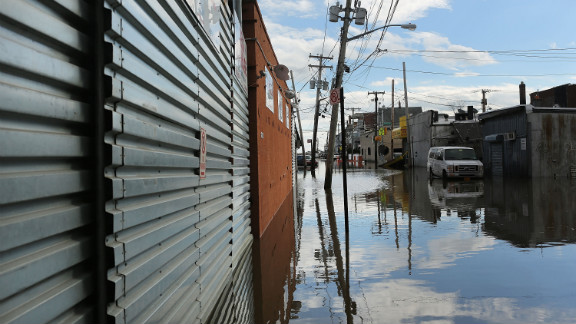 Water floods streets in the Rockaway section of Queens on Wednesday.