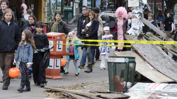 Luis C. Muniz snapped this photo of trick-or-treaters in Brooklyn making their way amid damage brought on by Superstorm Sandy.