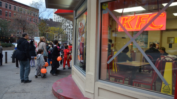 "Kaplan said there was an unusual atmosphere in the streets. ""Stores did not have any decorations, or had tape and boards over the front windows. Half of them are still closed down. And the half that were open were almost all out of candy,"" she said."