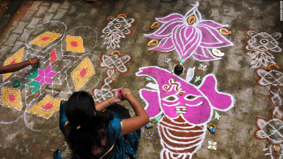 In villages, the rangolis are drawn on top of fresh cow dung. The purpose of the rangoli is to welcome guests and to encourage the Hindu goddess Lakshmi inside.