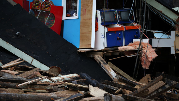 The arcade at the FunTown pier in Seaside Heights is in ruins. Storm damage is expected to cost tens of billions of dollars.