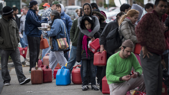 People wait in line for fuel at a Shell Oil station onThursday in Fort Lee, New Jersey. Fuel shortages have led to long lines of cars at gasoline stations in many states.