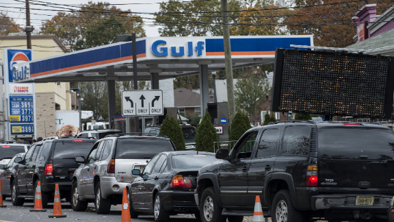 Cars wait in line for fuel at a Gulf gas station in Fort Lee, New Jersey.