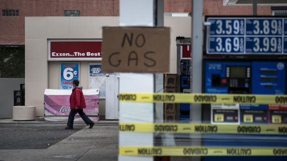 A woman leaves an Exxon gas station that was out of fuel on Thursday in North Bergen, New Jersey.