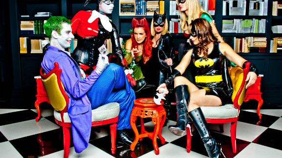 "Just in time for Halloween, iReporter Adam Sternberg arranged for this Gotham City reunion in Las Vegas. Playing cards with the Joker are (left to right) Harley Quinn, Poison Ivy, Cat Woman, Robin and BatGirl. ""We put a lot of work into making this shot happen and we're really happy with the results,"" Sternberg says."