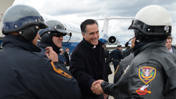 U.S. Republican Presidential candidate Mitt Romney greets policemen who were part of his motorcade as he prepares to board his campaign plane in Roanoke, Virginia on Thursday.