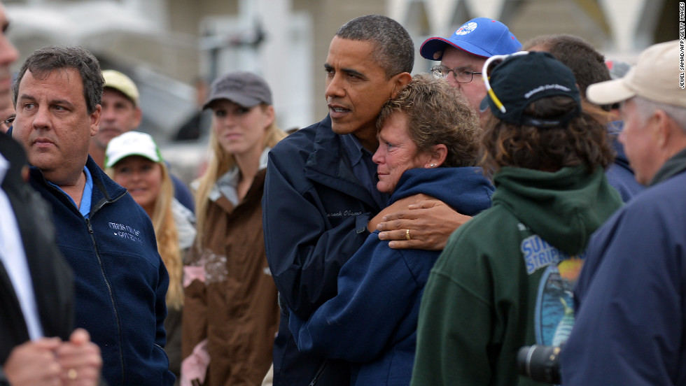U.S. President Barack Obama comforts Superstorm Sandy victim Dana Vanzant as he visits a neighborhood in Brigantine, New Jersey, on Wednesday, October 31.