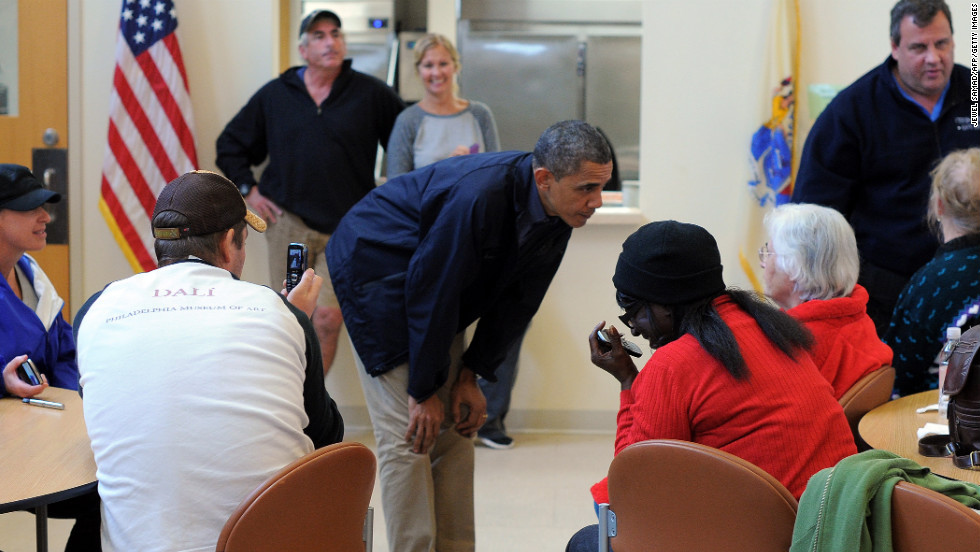 President Obama bends to talk to Sandy victims at a shelter in Brigantine.