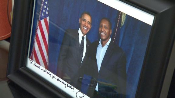 Ujiri poses alongside President Barack Obama, himself a keen basketball fan.