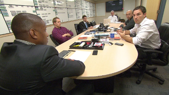 Ujiri meets with his backroom team. Ujiri has had a nomadic career which has seen him play, coach and scout across three continents.