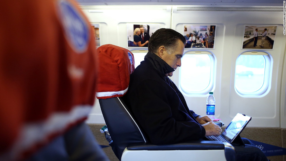 Republican presidential candidate Mitt Romney works aboard his campaign plane before takeoff Friday in Norfolk, Virginia.