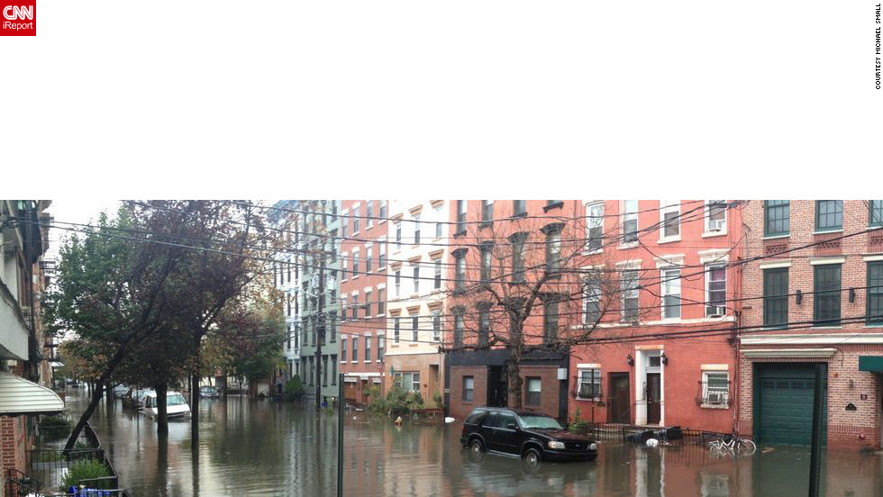 "This panoramic photo from Hoboken was taken Tuesday. iReporter Michael Small was evacuated from Lower Manhattan and went to a stay with a friend in Hoboken. Hoboken flooded, lost power and the waters smelled ""like gas and chemicals,"" he said. He is now back in New York."