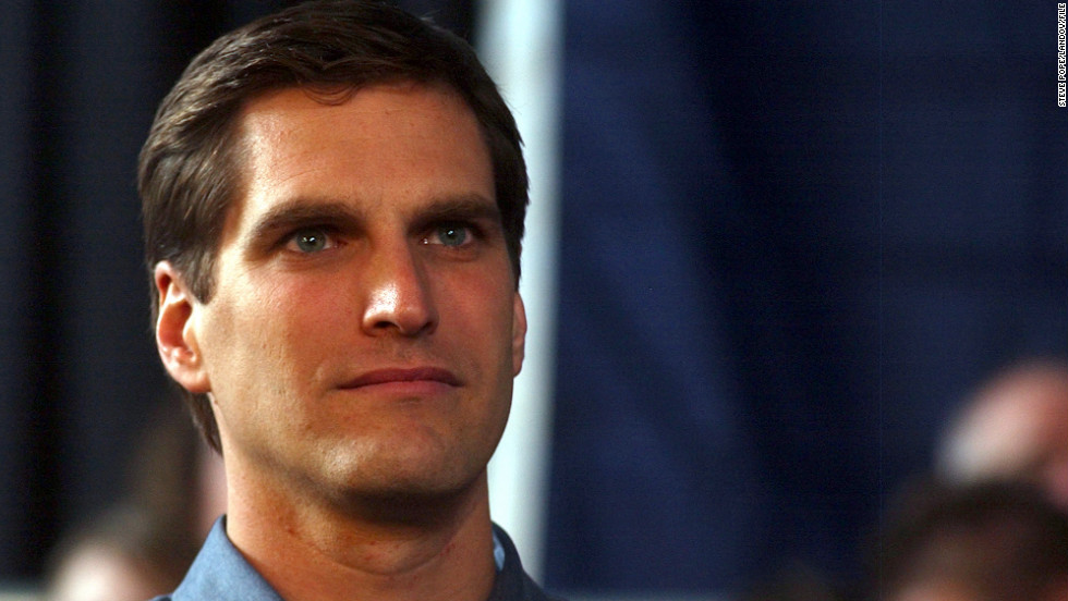 Mitt Romney's son Josh listens to his dad speak at a rally in Des Moines, Iowa, in 2007.