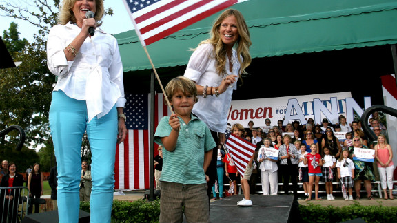 Ann Romney responds to cheering supporters with her grandson  Miles Romney and his mom, Mary Romney, in 2012.