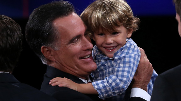 Mitt Romney holds his grandson Miles Romney at the conclusion of the final debate in 2012.