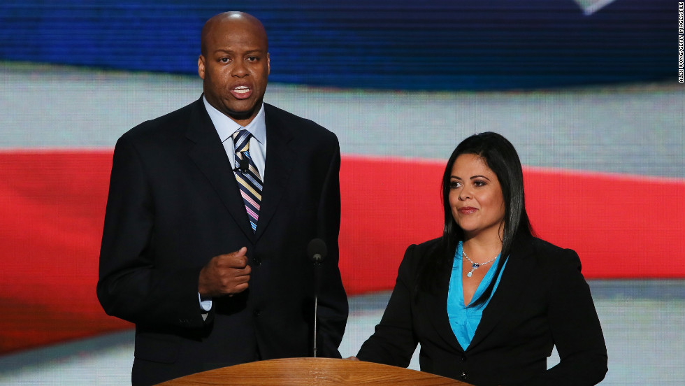 First lady Michelle Obama's brother Craig Robinson and Dr. Maya Kassandra Soetoro-Ng, President Obama's sister, speak on stage during the first day of the 2012 Democratic convention.