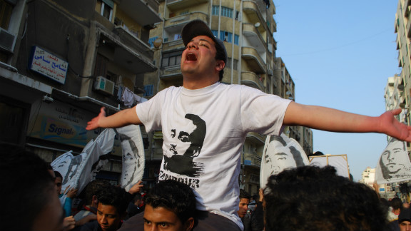 Marches were held across Egypt to honor the dead. Here a member of the Ahlawy leads marchers in song in the northern city of Alexandria. The soccer league was canceled. In their aim to achieve justice for the dead, the Ahlawy has launched a successful direct action campaign against the restart of the soccer league until the trial of those accused of the Port Said tragedy is completed.