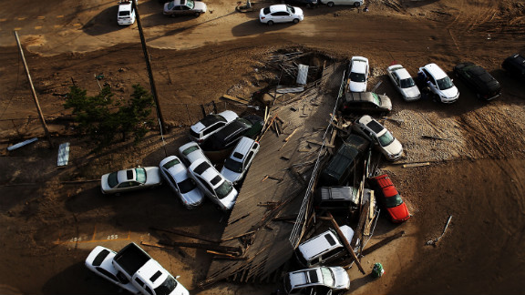 Abandoned and flooded cars are piled up on Friday, November 2, in the heavily damaged Rockaway neighborhood, in Queens, where a large section of a landmark boardwalk was washed away.